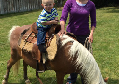 Melinda and son, pony rides with friends