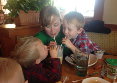 Melinda enjoying a summer smoothie with the boys.