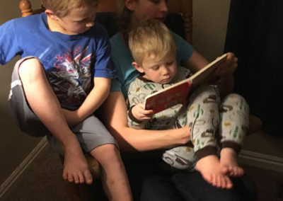 Mommy Melinda reading books with our boys!
