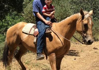 Russel and our little cowboy at family ranch!