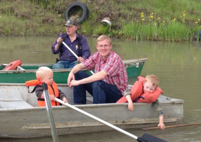 Russel boating with our boys at family ranch! Watch out for the fish!