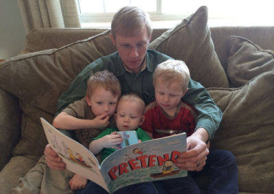 Russel reading to our boys