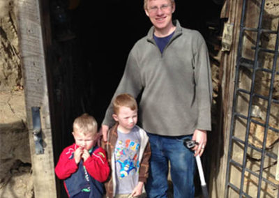 Russel touring historic mine with boys